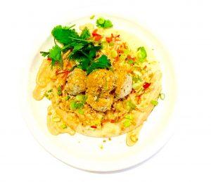 Thai pork meatballs with sweet chili Napa slaw, red curry yogurt, peanuts and naan